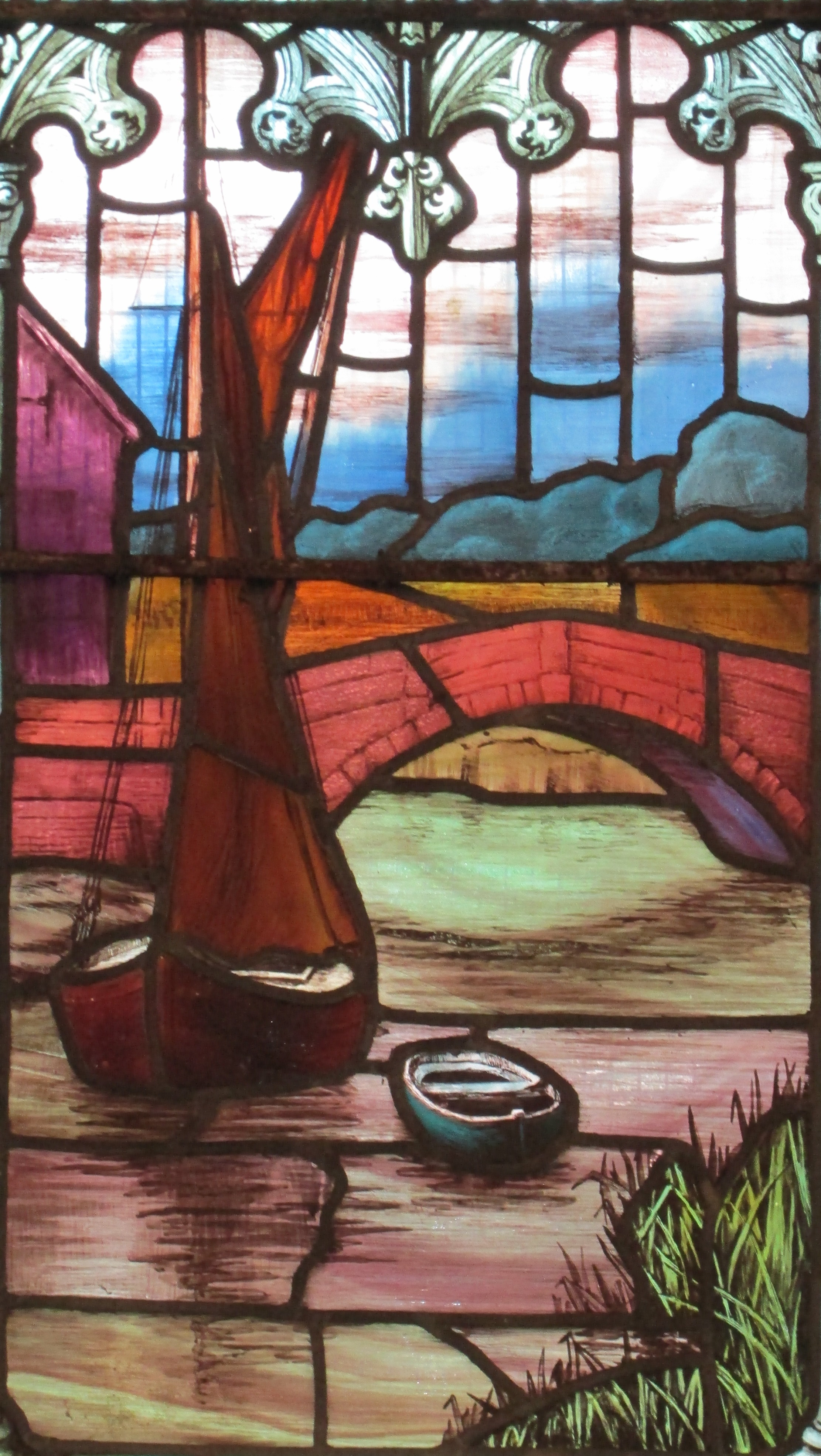 stained-glass window by Mary Lowndes featuring old Snape Bridge